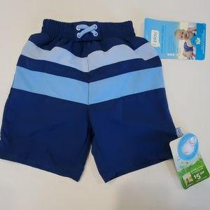 NWT blue swim trunks with ultimate swim diaper